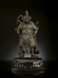 A FINELY CAST BRONZE GUARDIAN