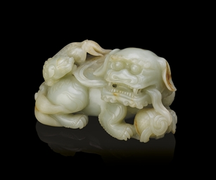 A FINELY CARVED WHITE JADE 'LI