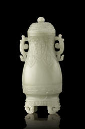 A RARE PALE CELADON JADE ARCHAISTIC VASE AND COVER