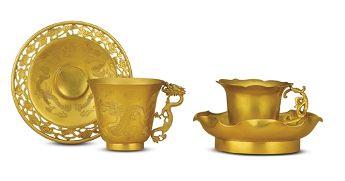 A GROUP OF GOLD VESSELS