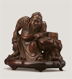 A RARE AND FINELY CARVED BAMBO