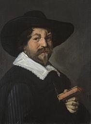 Portrait d'homme tenant un liv