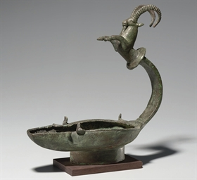 A SOUTH ARABIAN BRONZE OIL LAM
