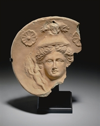 A GREEK TERRACOTTA ROUNDEL
