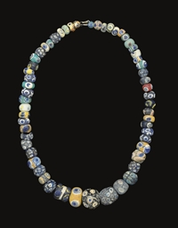 A PHOENICIAN GLASS EYE BEAD NE