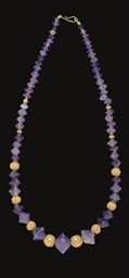 A GREEK AMETHYST BEAD NECKLACE