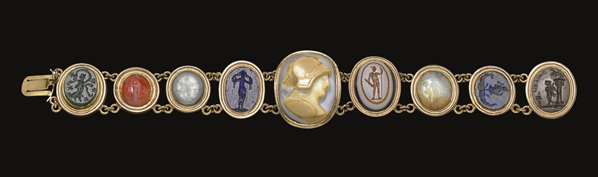 A BRACELET OF NINE ROMAN RINGS