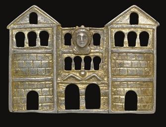 A ROMAN GILT SILVER FIBULA