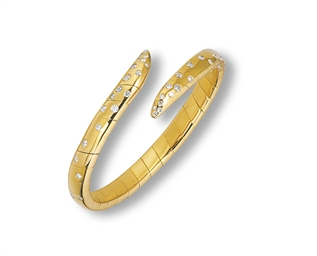 A DIAMOND AND GOLD BANGLE, BY