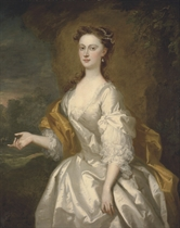 Portrait of Miss Rachel Long, three-quarter-length, in a white dress with a yellow mantle, a park landscape beyond