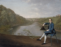 Portrait of Philip Howard of Corby Castle, Cumberland, small full-length, in a blue coat, seated holding a tricorn hat in his right hand, on the banks of the River Eden, Corby Tower beyond