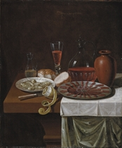 A flute and decanter of wine, a glass water pitcher, two hunks of bread, a plate of oysters, a plate of sliced ham, a clay jug, a knife and a lemon on a wooden table partly covered with two tablecloths