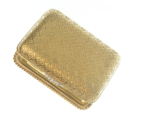 AN 18K GOLD AND DIAMOND COMPAC