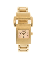 AN 18K GOLD 'MISS PROTOCOLE' W