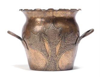 A HAMMERED COPPER TWIN-HANDLED