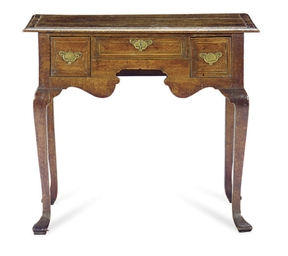 AN ENGLISH OAK DRESSING TABLE,
