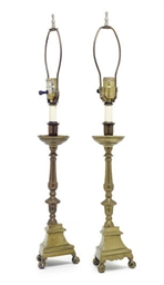 A PAIR OF BRASS TRIPOD CANDLES