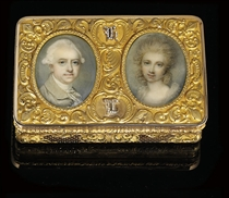 A FRENCH GOLD SNUFF-BOX SET WITH TWO ENGLISH PORTRAIT MINIATURES