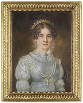 A young lady, in light blue satin dress with Renaissance-style ruched sleeves and sheer white starched double-frilled lace collar, double-strand pearl necklace with emerald-set clasp about her neck, opera-length double strand of pearls centred by a gold-mounted emerald jewel with pendant crucifix, pearl-set gold tiara in her upswept curling brown hair