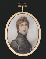 A boy, in Van Dyck dress, black slashed doublet, standing white lawn collar, curling brown hair