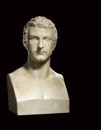 A CARVED MARBLE HERM BUST OF A
