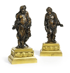 A PAIR OF BRONZE FIGURES OF AE