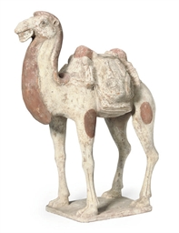 A CHINESE POTTERY CAMEL