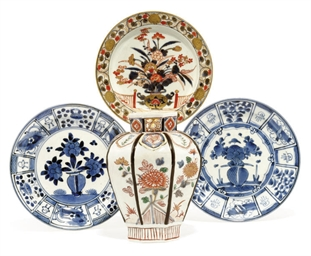 AN IMARI VASE AND THREE DISHES