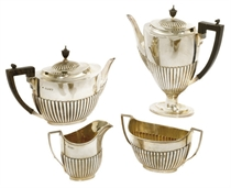 A LATE VICTORIAN FOUR-PIECE SILVER TEA AND COFFEE SERVICE