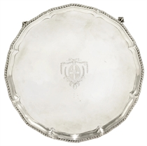 A GEORGE III SHAPED CIRCULAR SILVER SALVER