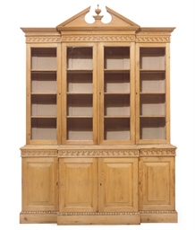 A PINE BREAKFRONT BOOKCASE