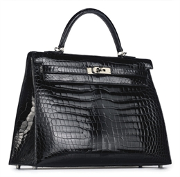 A BLACK CROCODILE KELLY BAG
