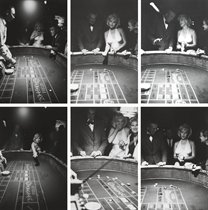 Marilyn Monroe throws the dice during the filming of The Misfits, 1960