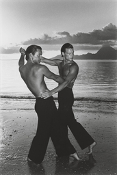 Two men dancing on the beach,