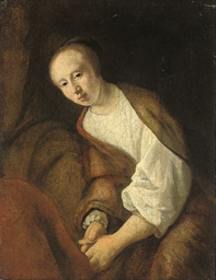 A young woman in an interior: