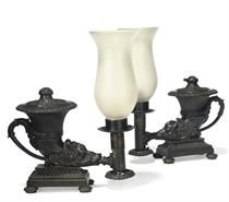 A NEAR PAIR OF REGENCY BRONZE COLZA-OIL RHYTON LAMPS