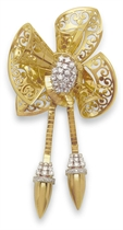 A RETRO DIAMOND AND GOLD BOW BROOCH