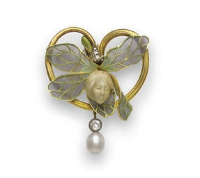 **AN ART NOUVEAU IVORY, DIAMON