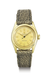 ROLEX. A 10K GOLD WRISTWATCH W