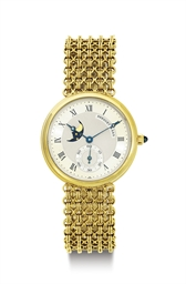 BREGUET. AN 18K GOLD WRISTWATC