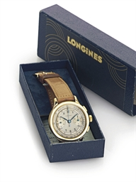 LONGINES. A 14K GOLD CHRONOGRA