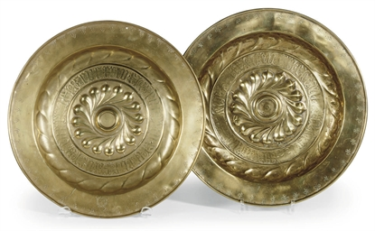 TWO SIMILAR BRASS ALMS DISHES