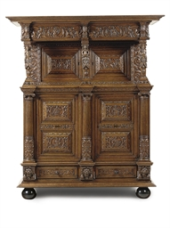 A DUTCH CARVED OAK CUPBOARD