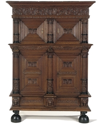 A DUTCH CARVED OAK CUPBOARD 'K
