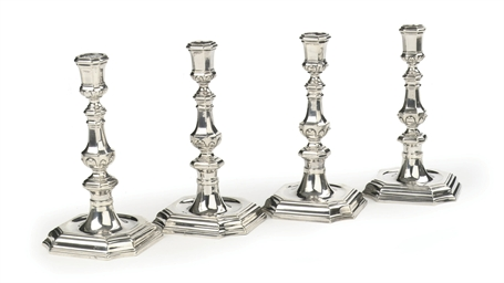 Four Dutch silver candlesticks