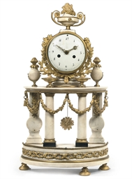 A LATE LOUIS XVI ORMOLU-MOUNTE