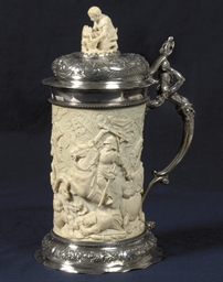 A GERMAN SILVER-MOUNTED CARVED