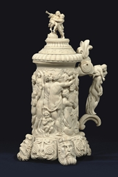A LARGE CARVED IVORY TANKARD