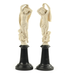 A PAIR OF CARVED IVORY GROUPS