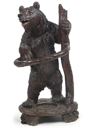 A SWISS CARVED WOOD BEAR UMBRE